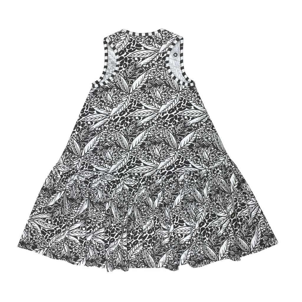 Back view of cotton beach dress in striking and bold black and white painted tropical and animal print
