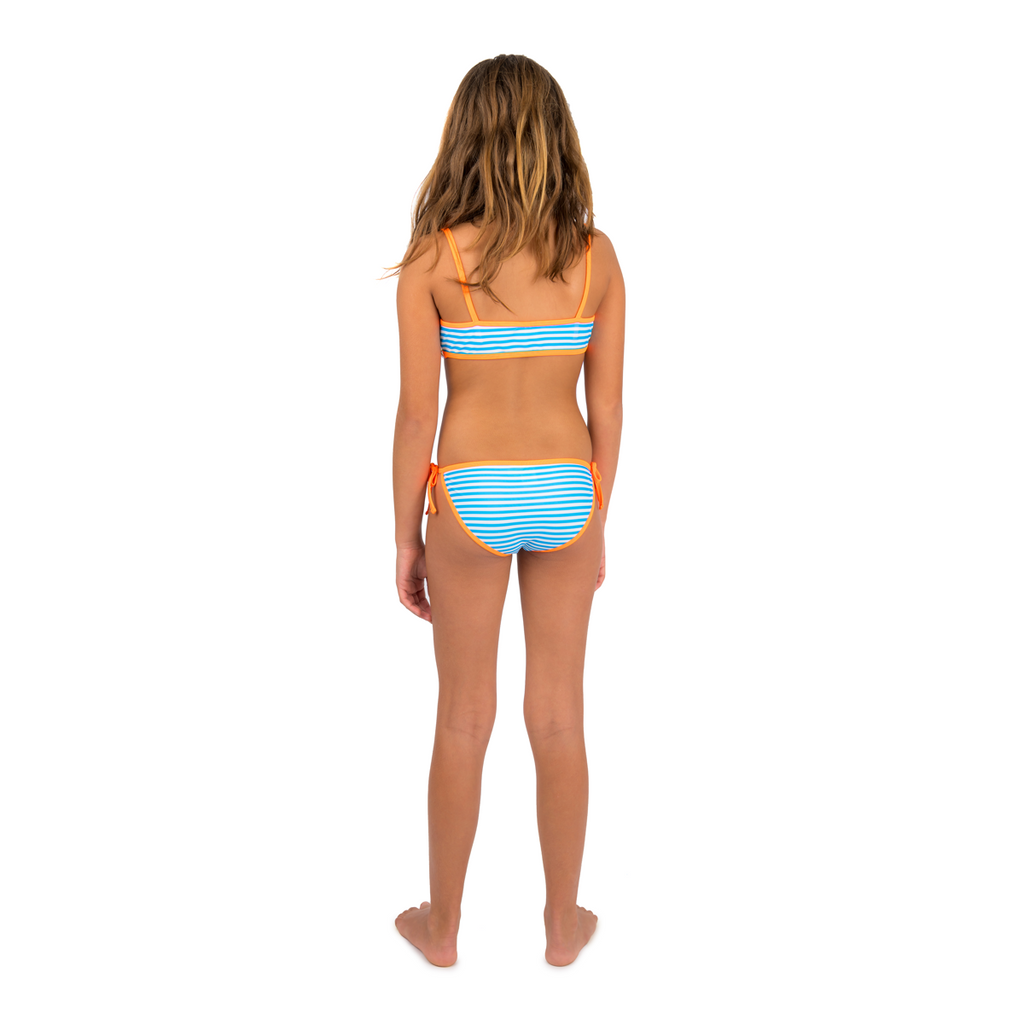 Back view of girl wearing bright blue and white stripe bikini with contrast neon orange trim. Classic tie side bottoms with simple scooped bikini top.