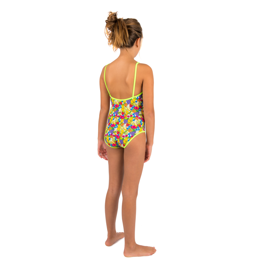 Back view of girl wearing tutti frutti print swimsuit. Multi colour fruit mix with contrast neon green trim and straps