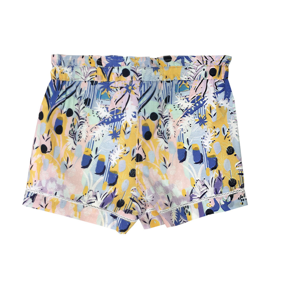 Back view of tailored shorts in a beautiful pastel tropical artwork. pockets at the front, elasticated waist and drawstring tie