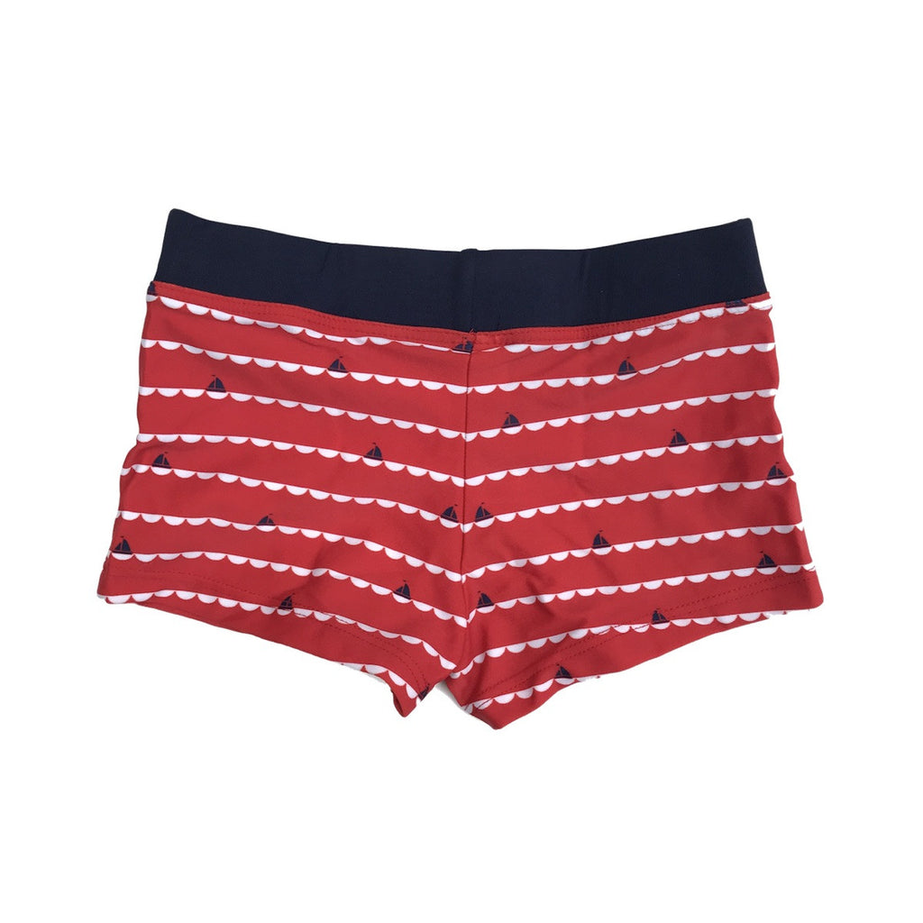 Red and white stripe fitted swim shorts with small navy boat print. Wide waistband at waist.