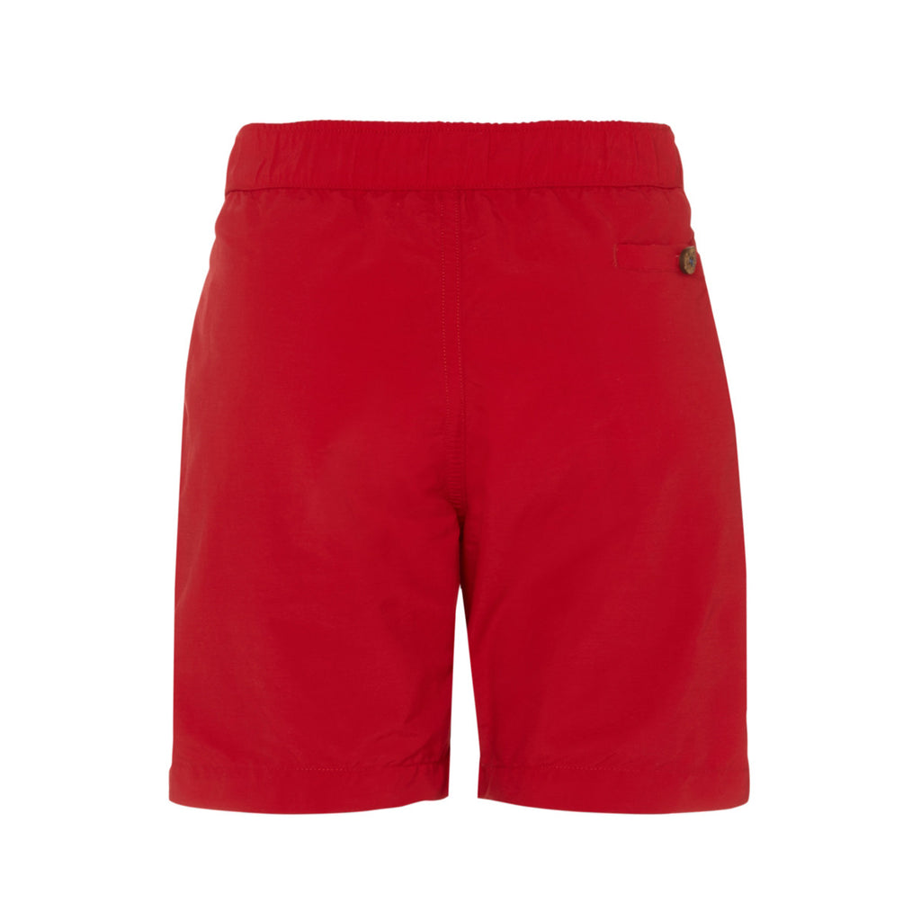 Back view of boys red tailored swim shorts showing pocket detail with button