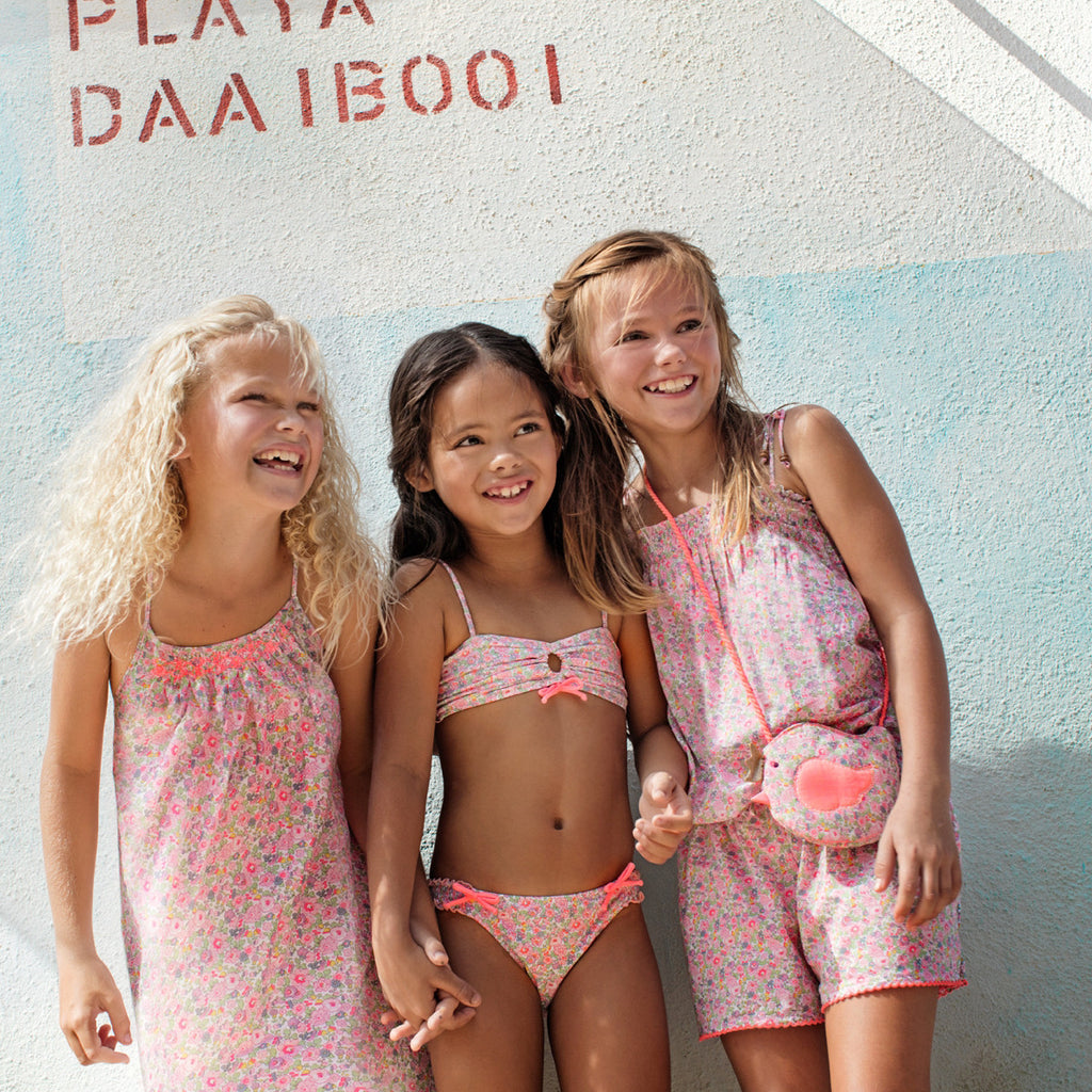 Girls wearing Sunuva Liberty print swim and beachwear