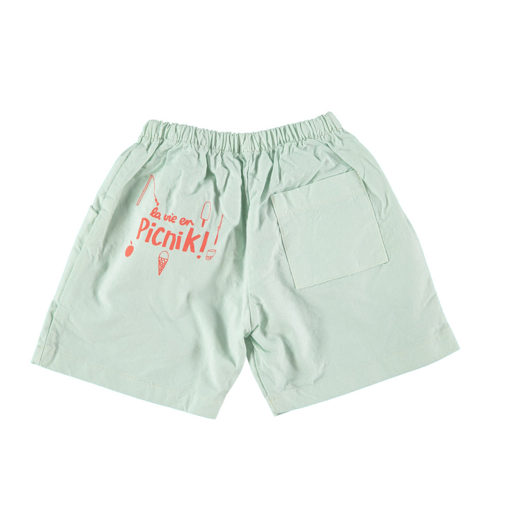 Back view of cotton Bermuda shorts in mint green with 'picnik' design on reverse. 100% cotton with elasticated waist and side and back pockets