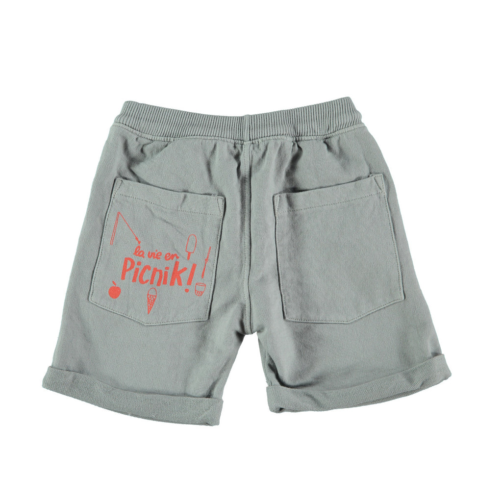 Back view of jogger style cotton shorts in grey with 'picnik' design on back pocket. 100% cotton with loose turn up, elasticated waist and tie string to front. Pockets at side and back