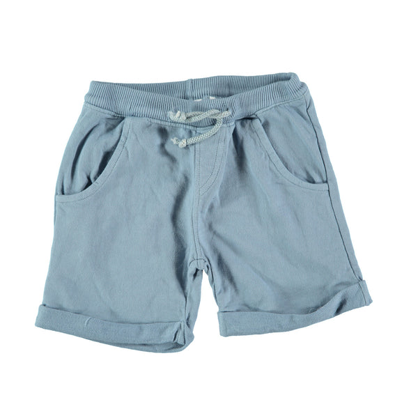 Jogger style cotton shorts in mid blue with 'picnik' design on back pocket. 100% cotton with loose turn up, elasticated waist and tie string to front. Pockets at side and back