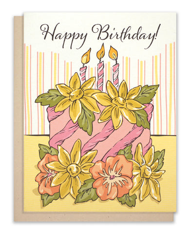 Birthday card of a cake with sunflowers and pansies
