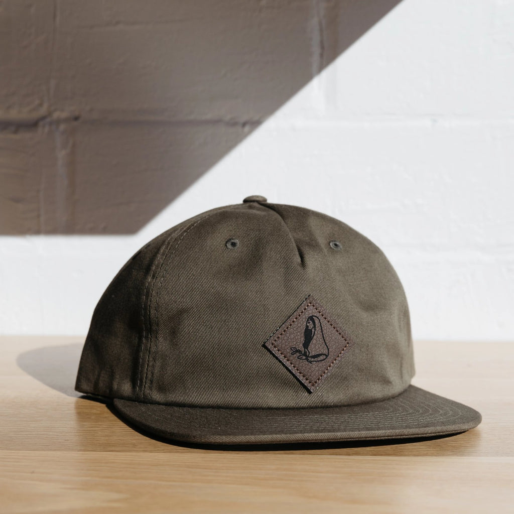 Green cap w/ leather label-tag