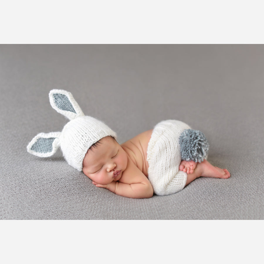 white bunny hat and pants set for newborn photography photoshoot with pink ears and tail