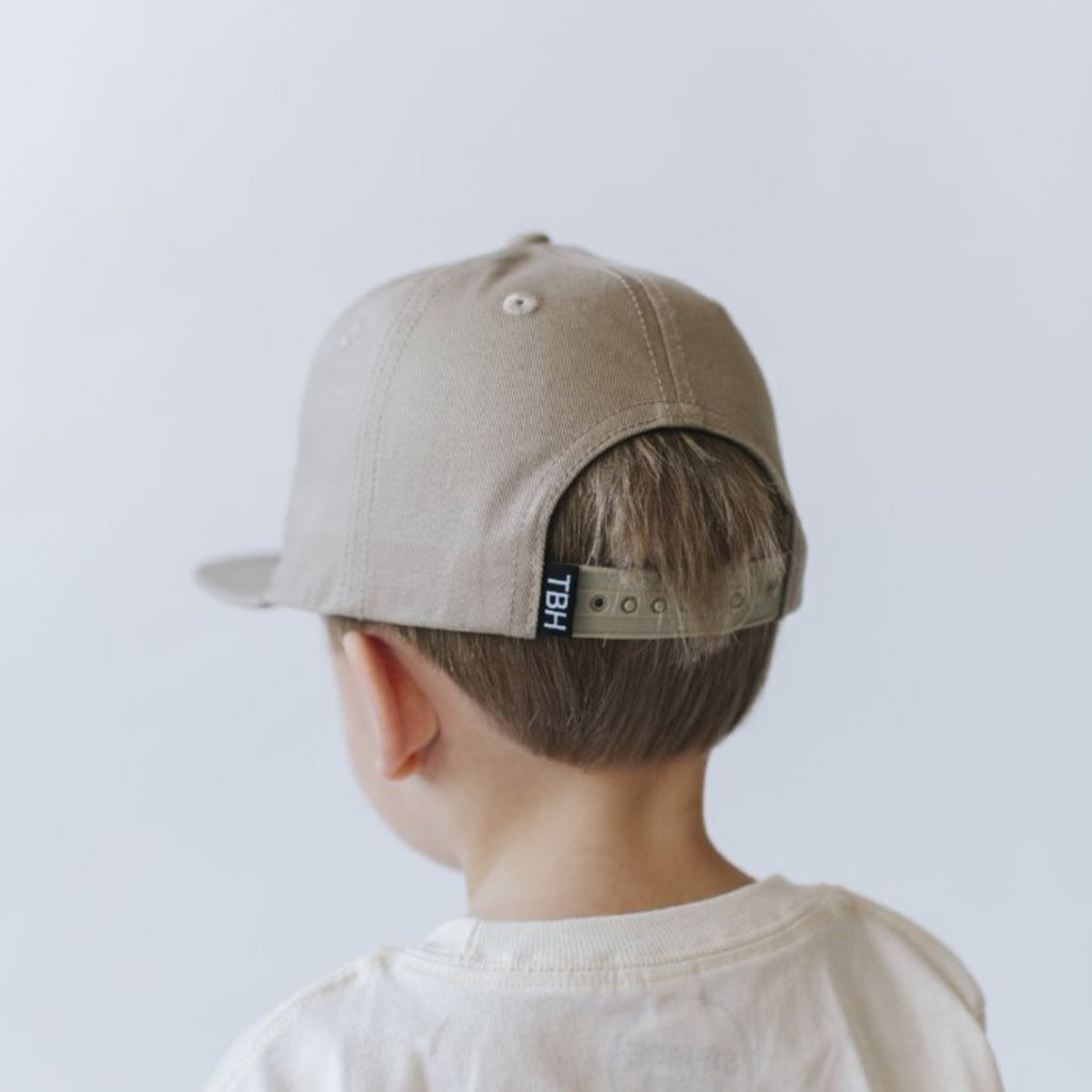 Tan snapback with bear image and logo
