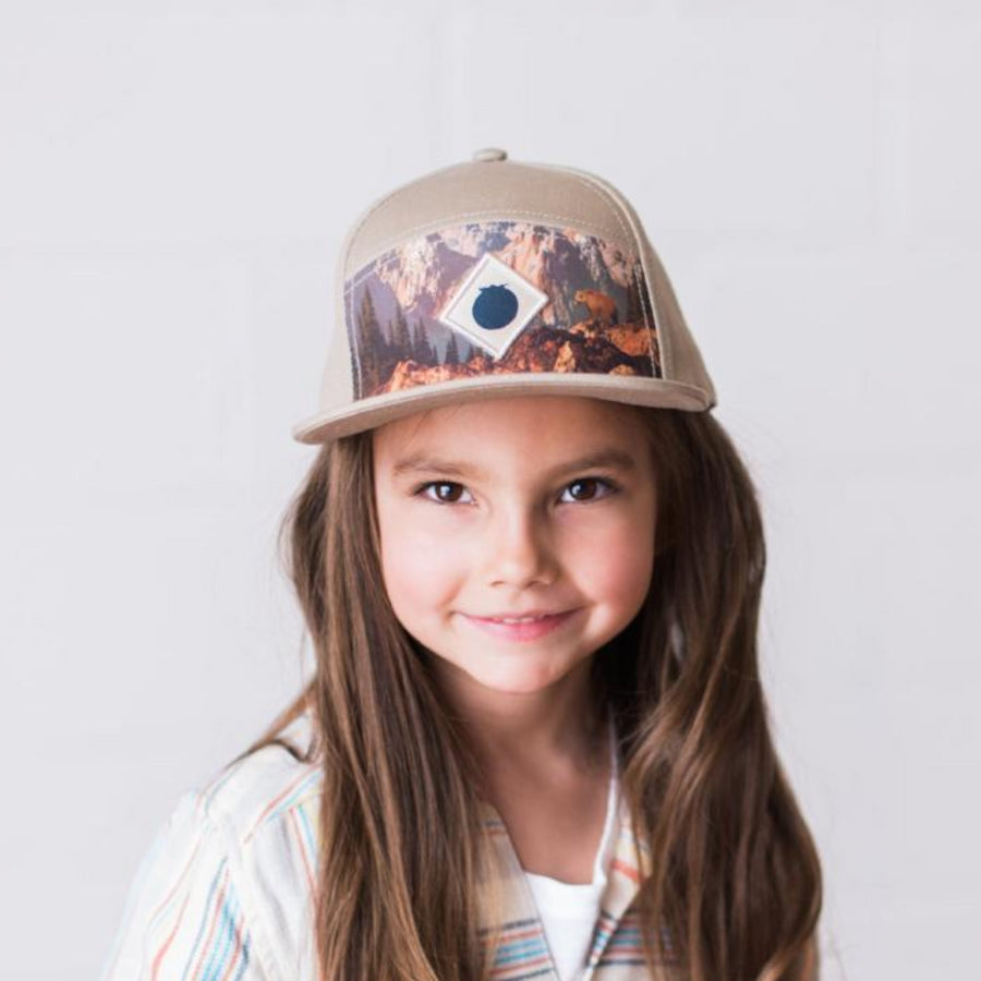 tan snapback baseaball hat with bear print and blueberry logo