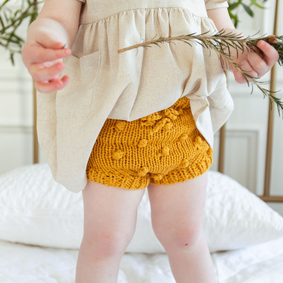 hand knit cotton bloomers with popcorn knit in mustard yellow for baby infant toddler