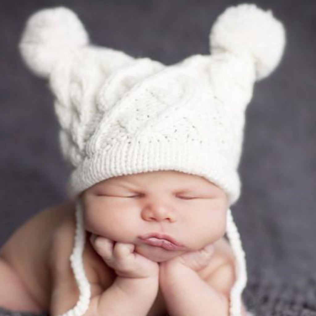 cable knit hat for baby with poms and tassels cream