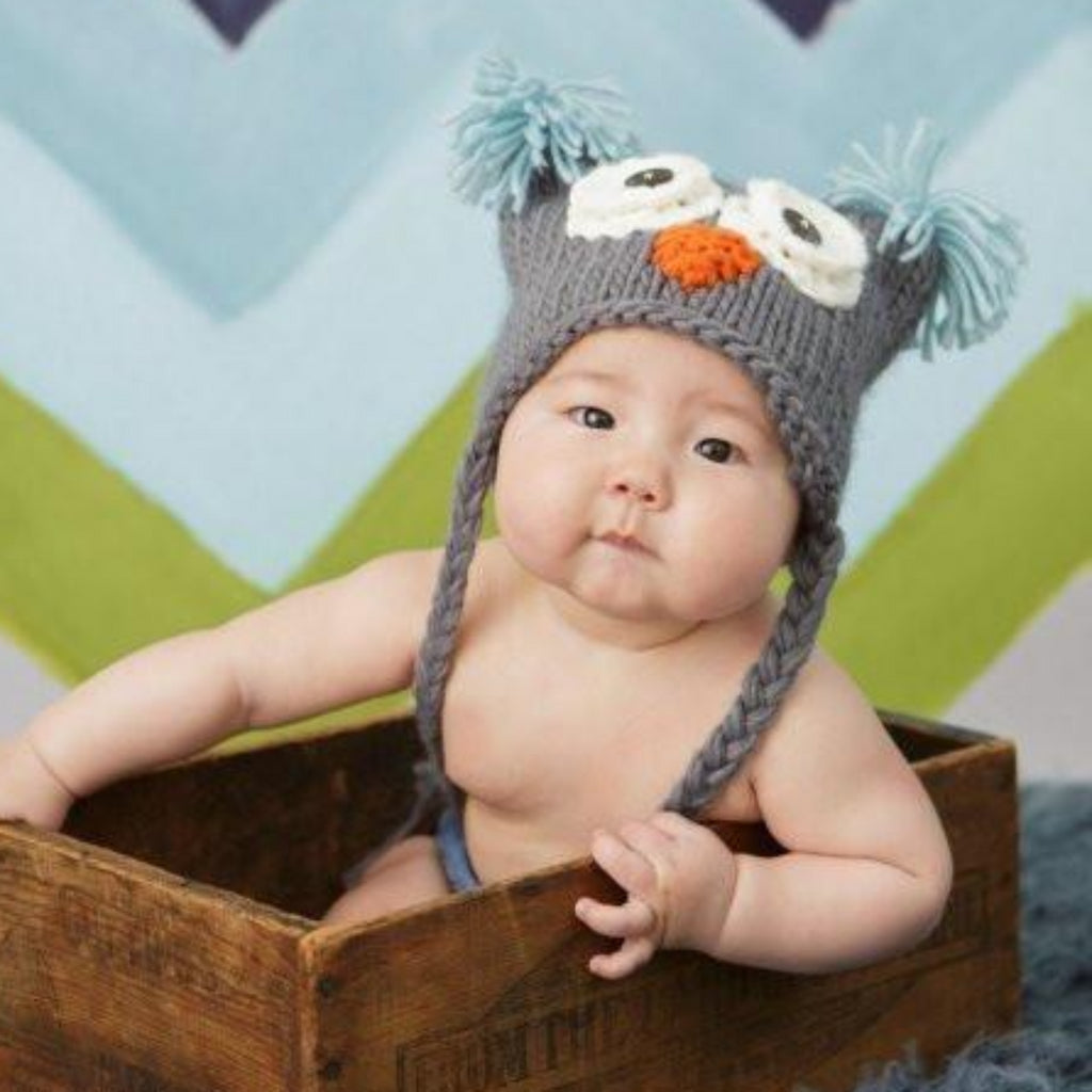 Grey owl hat with tassels and sky blue tufts