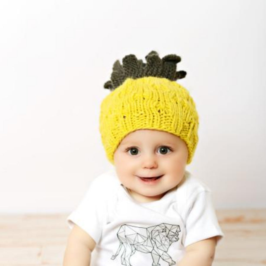 hand knit yellow pineapple hat for baby with green leaves accent