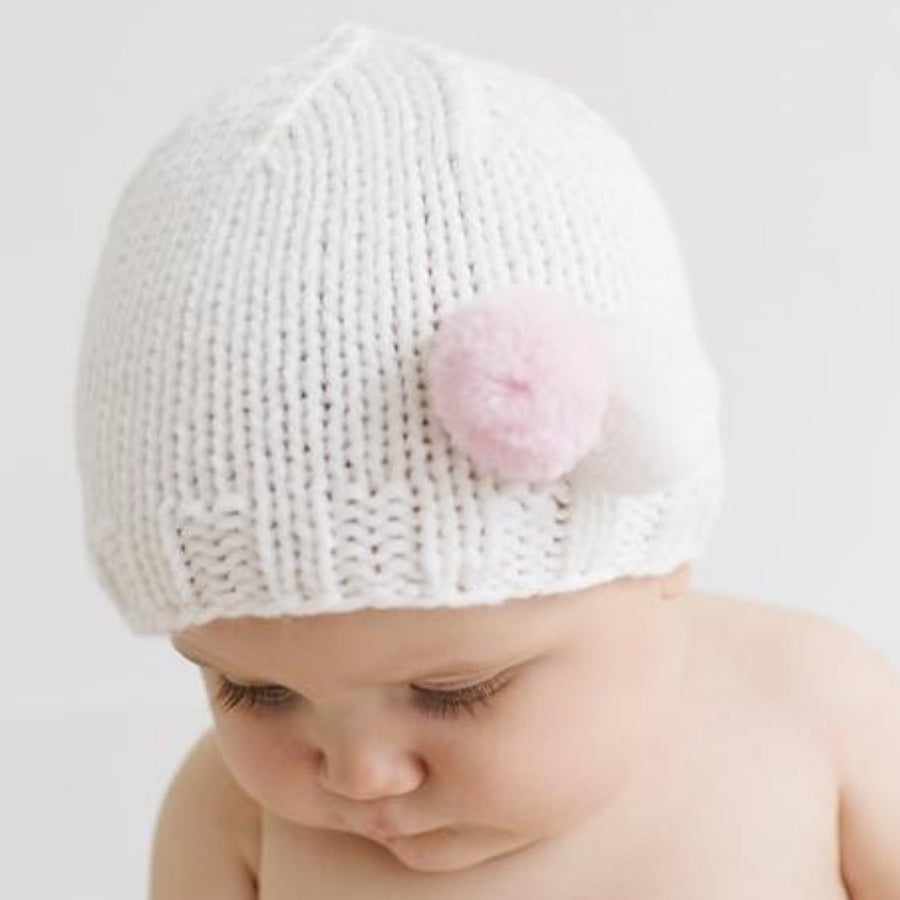 Cream hat with white and gray tiny pom