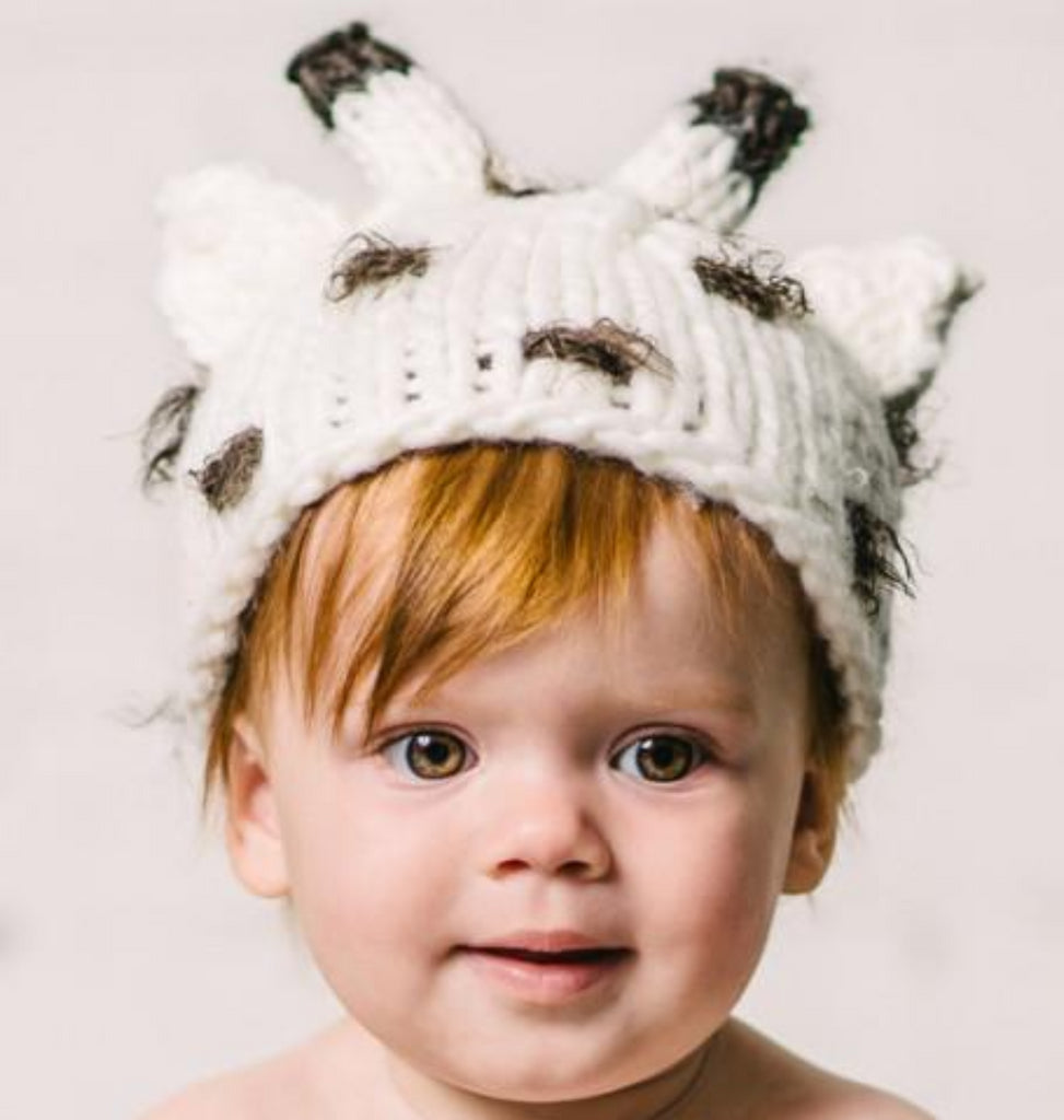 Cream giraffe hat with brown spots