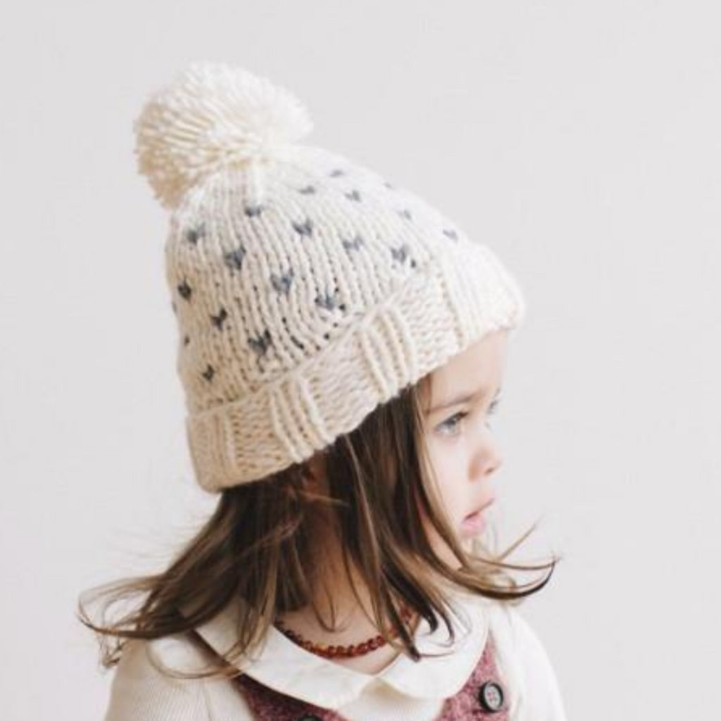 cream hat with gray fair isle hearts and pom