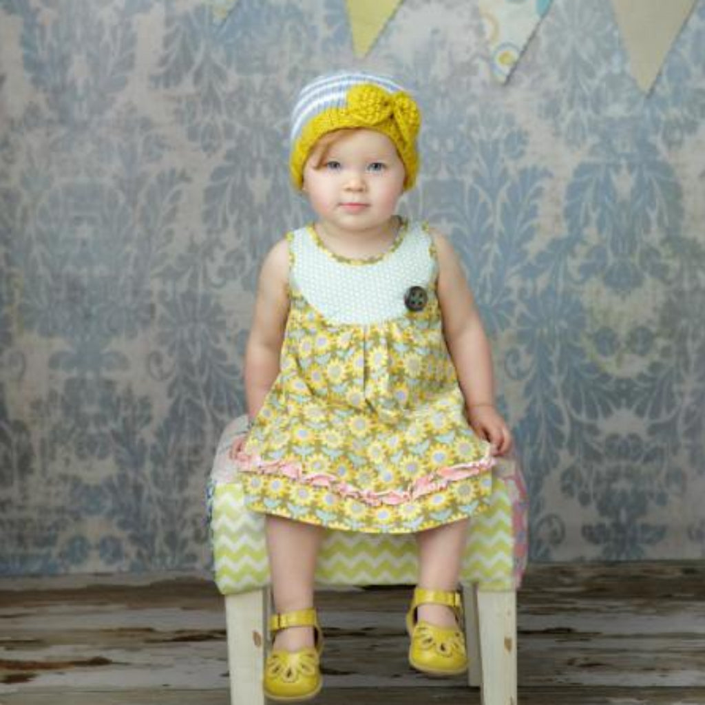 Grey and white striped hat with yellow bow