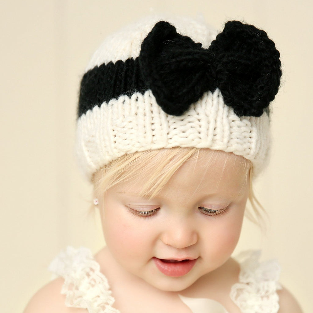 Knit hat for baby and toddler with bow in cream and black