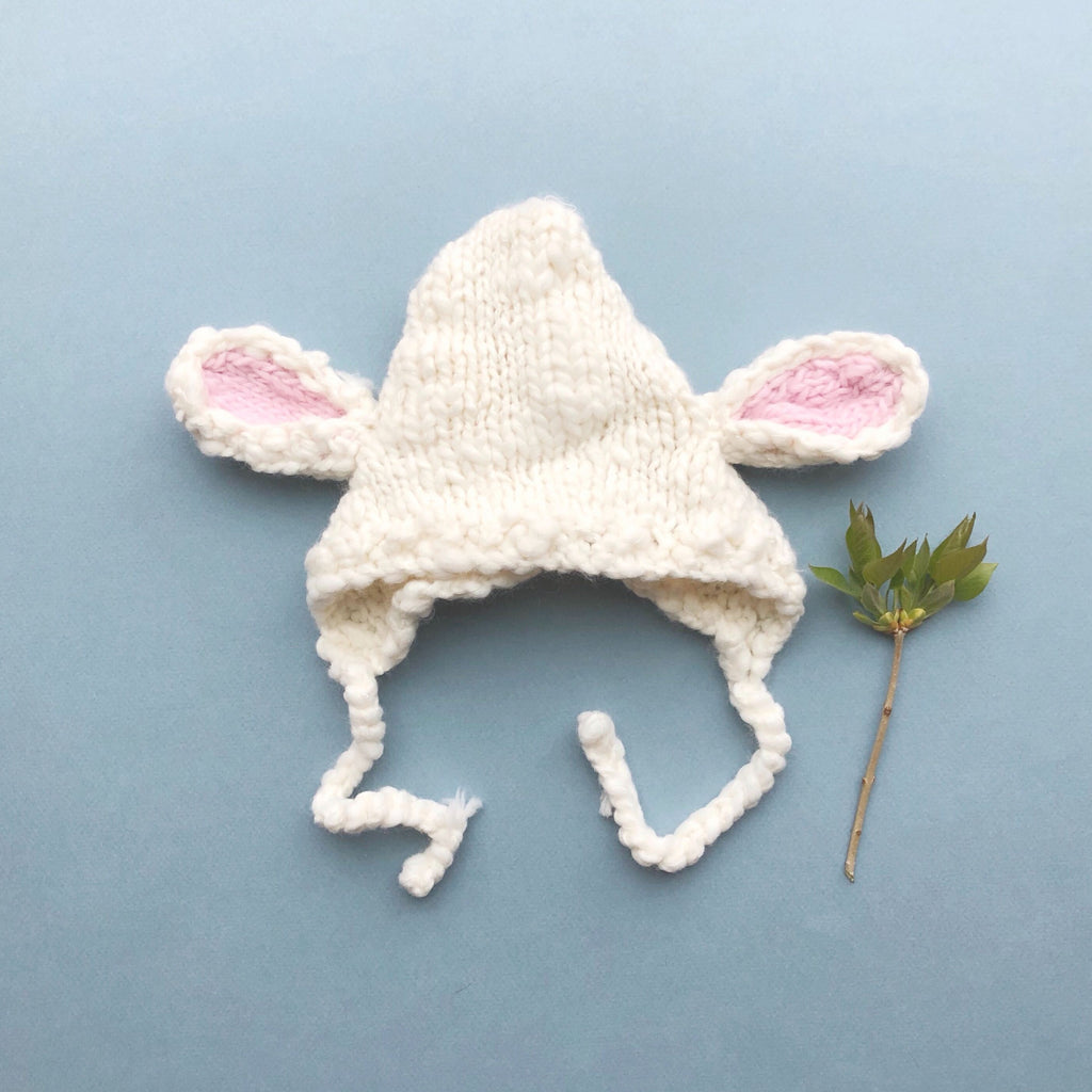 hand knit lamb bonnet for baby in cream with pink ears