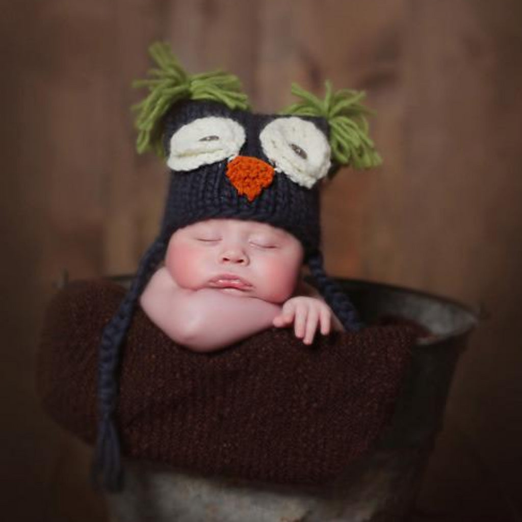 Navy owl hat with tassels and green tufts