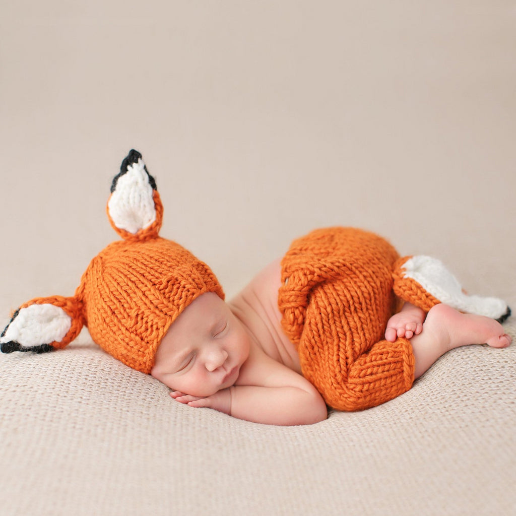 hand knit orange fox hat and pants set for baby with white ears and tail