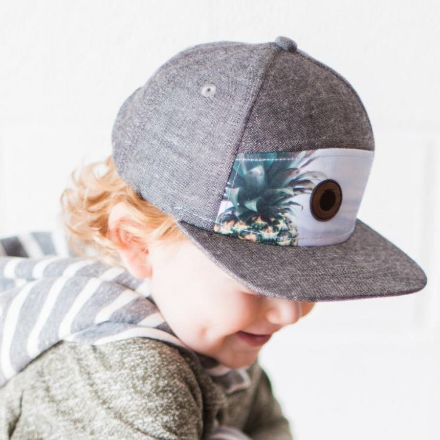 gray snapback hat for toddler with pineapple image on front panel and leather logo