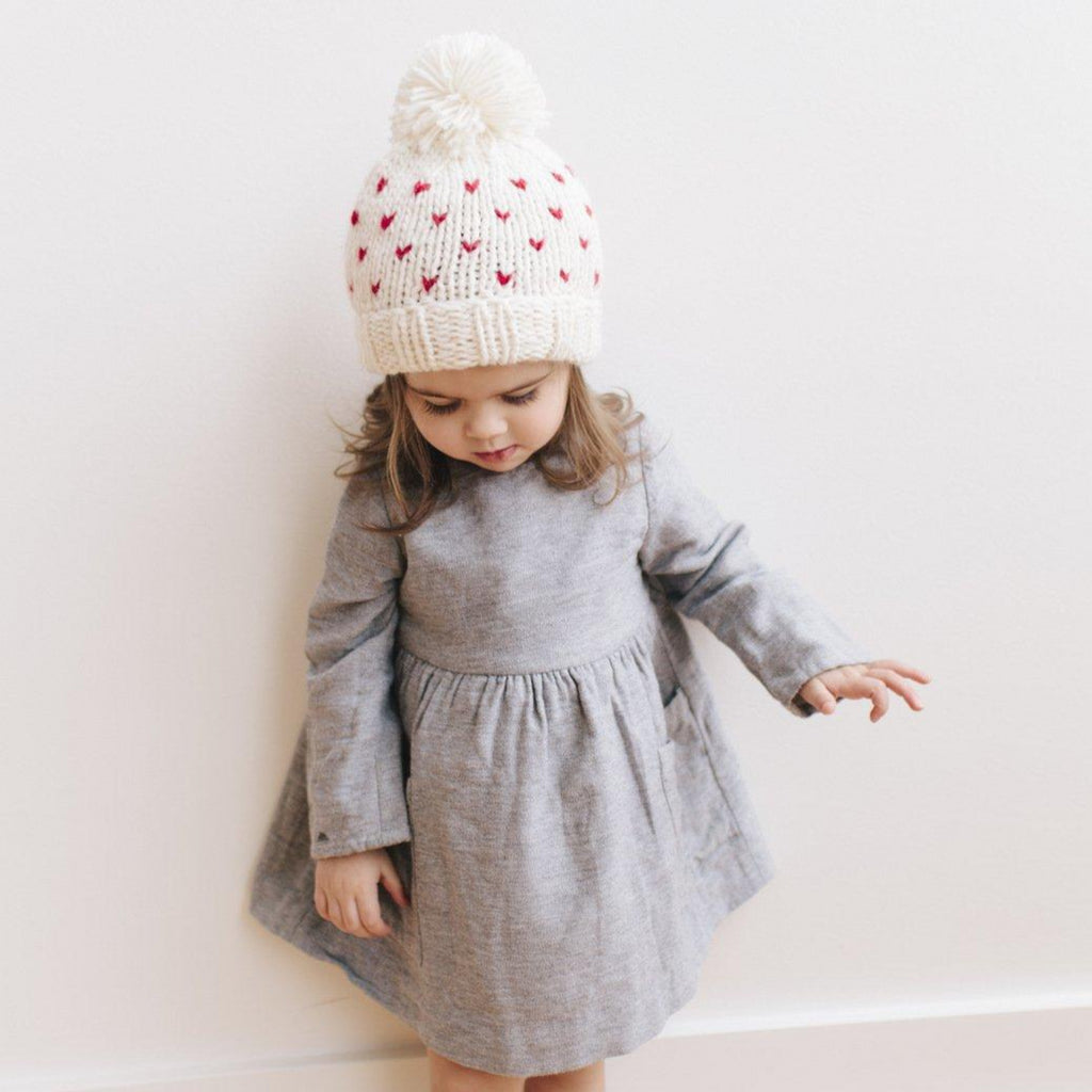 Cream hat with tiny red hearts