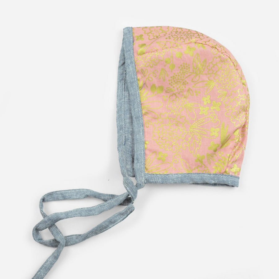 reversible cotton bonnet for babies in chambray with pink and gold print