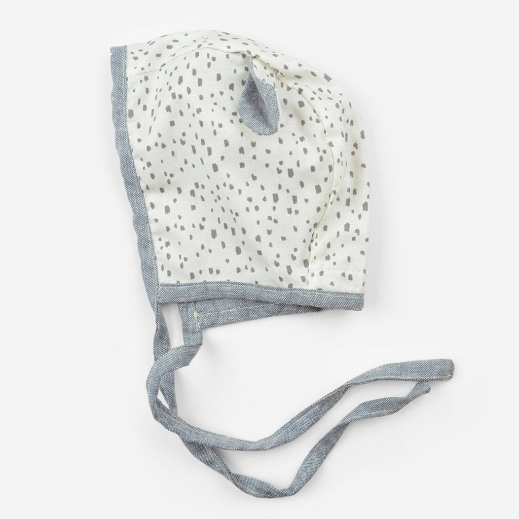 reversible cotton bonnet for babies in chambray  and ears with white with black spots print fabric