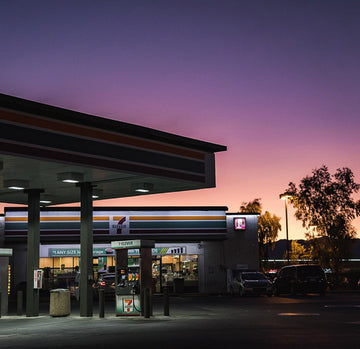 seven eleven gas station with sunset