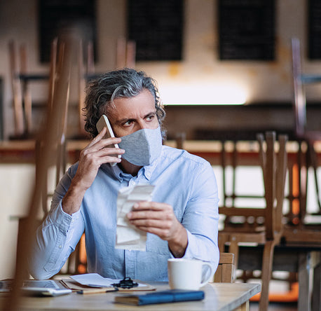 man on the phone at a coffee shop