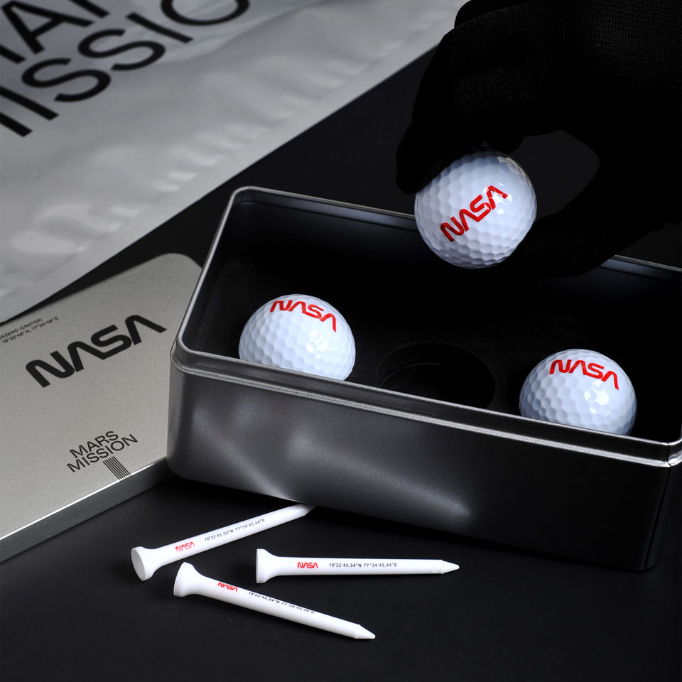 The Mars Swing golf set comes in three balls featuring NASA's worm logo and three tees printed with coordinates of Jezero Crater in a premium metal case.