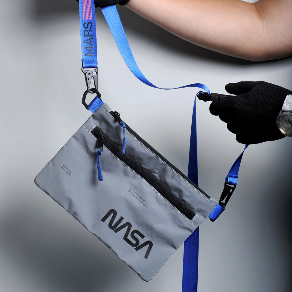 NASA astronautical wear inspired messenger bag made with reflective and waterproof textile. A collaboration with Elephat Urban Equipment.