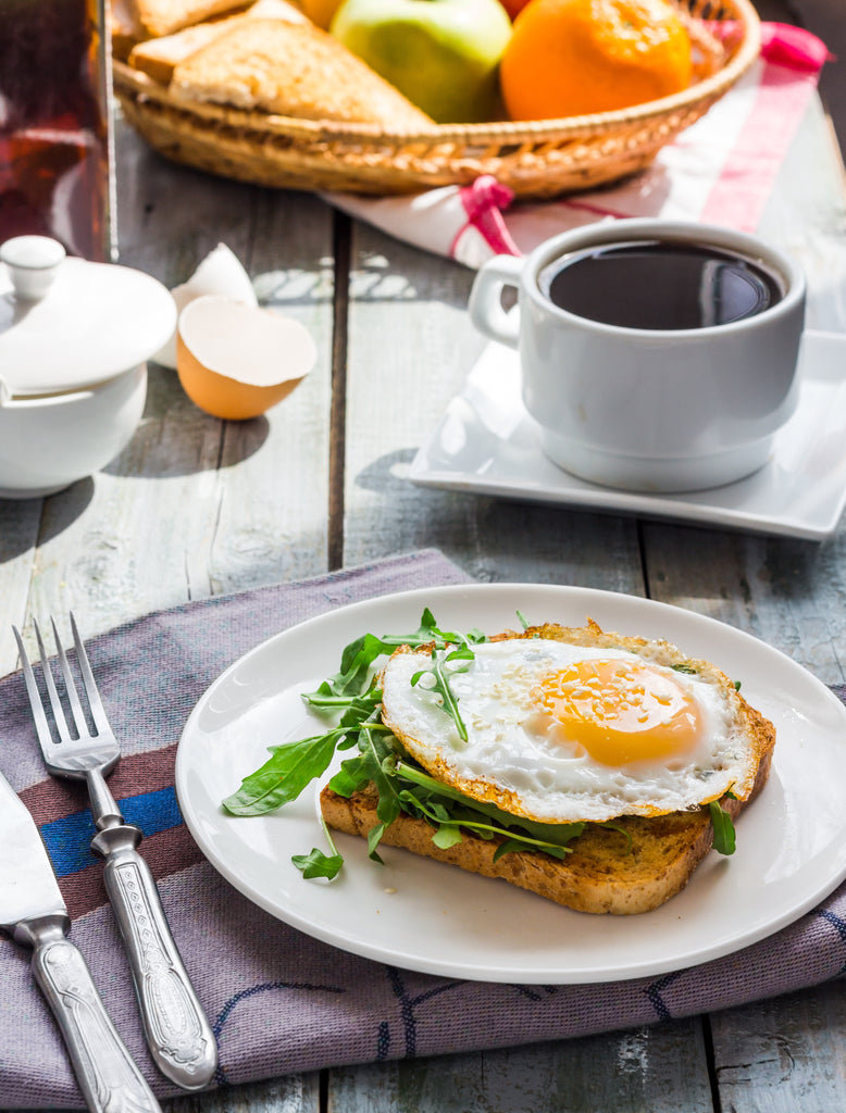 Open-Faced Sandwiches with Ricotta, Arugula, and Fried Egg