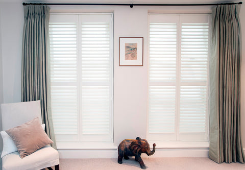 white full height shutters in a living room
