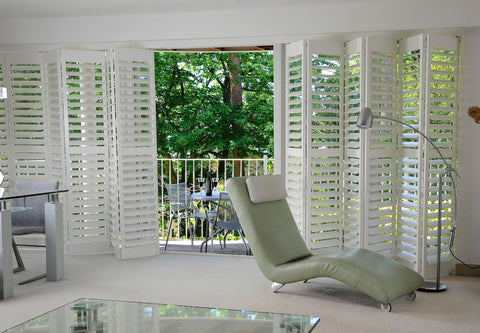 half open sliding white shutters in a modern room with