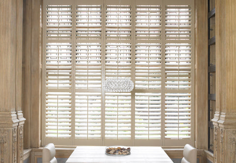 elegant stained teak shutters in a dining room