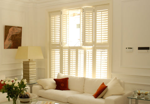 Partly opened tier on tier shutters allowing a greater control on the amount of light inside the room