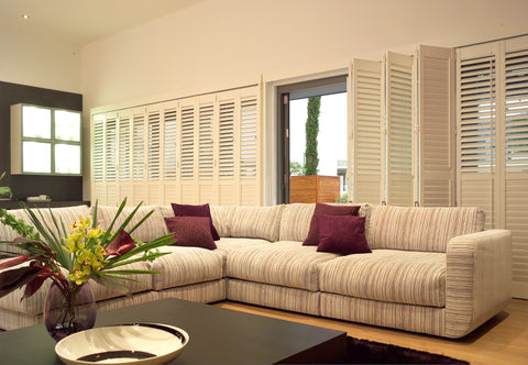 bifold sliding shutters used as room divider