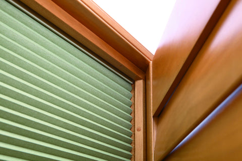 detail of blackout blinds mounted in a shutter frame