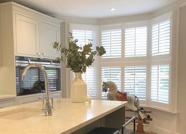 professionally fitted bay window shutters in a modern kitchen