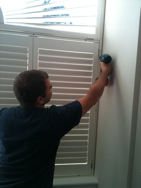 image shows a phase of an window shutter installation