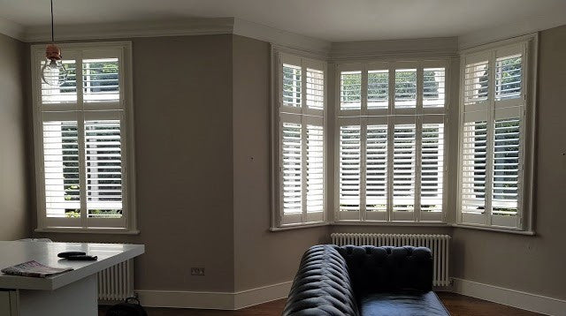 modern lounge with perfect shutters for the room style, white and modern tier on tier shutters