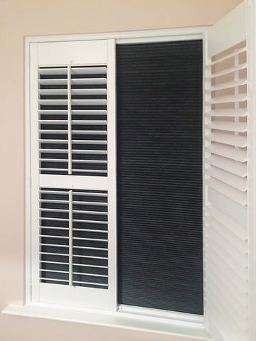 window with shutters and darkening blinds