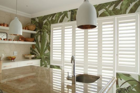 white aluminium shutters on a large kitchen window