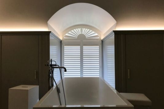 arched shutter in a bathroom