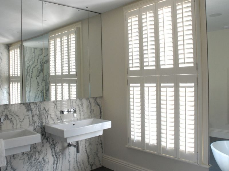 bathroom with tier on tier shutters