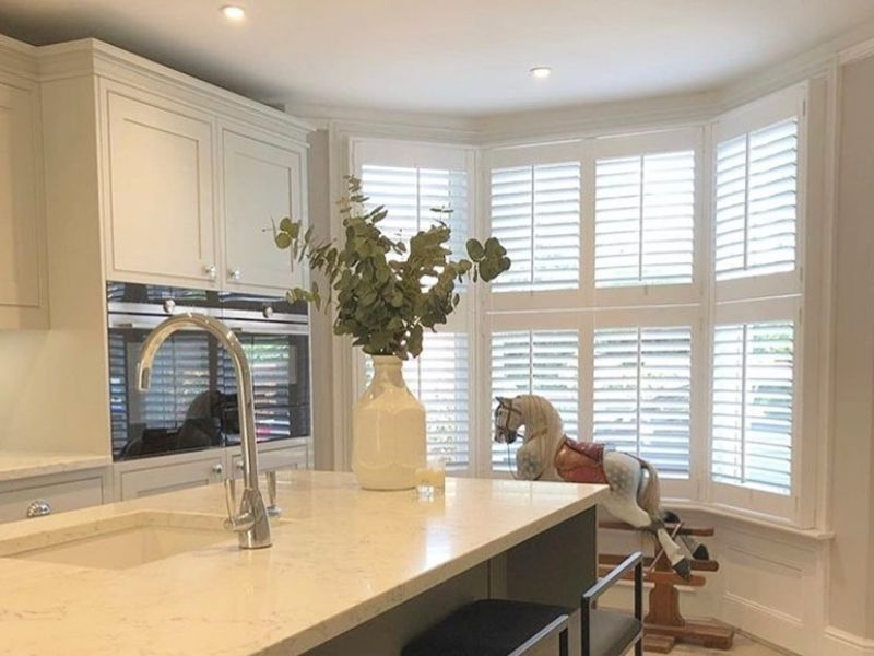 waterproof shutters in a bay window kitchen